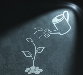 Watering can and sprout drawing  in spot of light