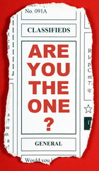 The question Are You The One? on a newspaper clipping