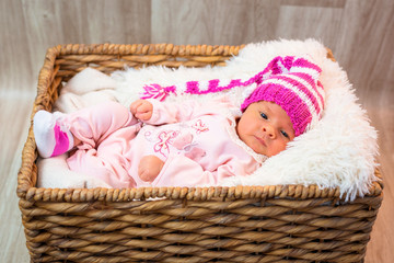Newborn baby girl in pink knitted hat