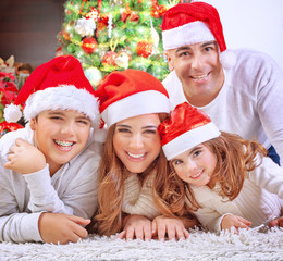 Happy family in Christmas eve