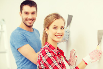 smiling couple doing renovations at home