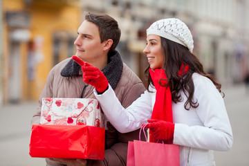 Young couple looking for Christmas presents