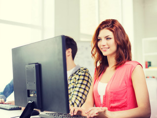 smiling female student in computer class