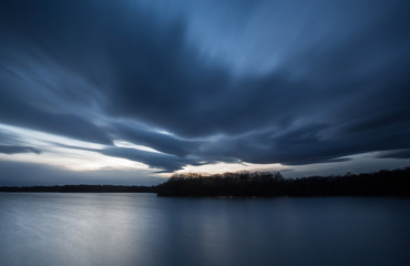 heavy clouds above lake