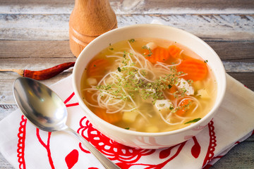 Chicken broth with vermicelli, vegetables and herbs