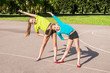 Two friend girls doing gymnastics outdoors