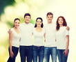 group of smiling teenagers in white blank t-shirts