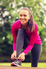 smiling woman exercising outdoors