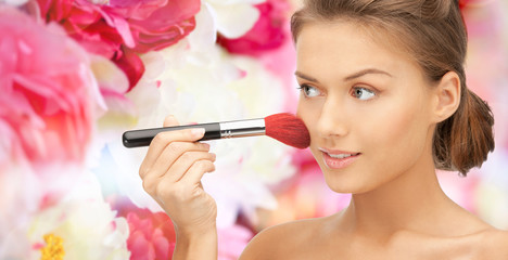 beautiful smiling woman with make up brush