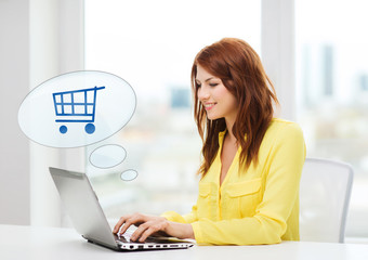 smiling woman with laptop computer shopping online