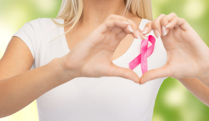 close up of woman and pink cancer awareness ribbon