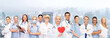 smiling doctors and nurses with red heart