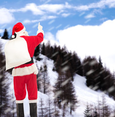 man in costume of santa claus with bag