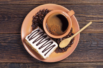 Plate with coffee and creamy cake
