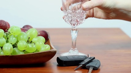 Drunk driving. Red wine and car keys.