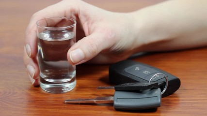 Drunk driving. Vodka and car keys.