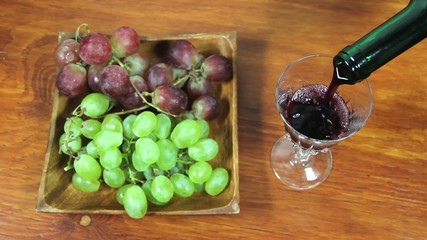 Pouring Red Wine Into A Glass. Grapes. 2