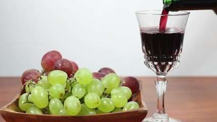 Pouring Red Wine Into A Glass. Grapes. 4