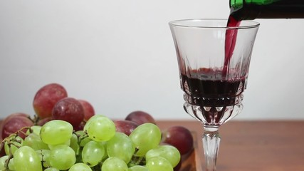 Pouring Red Wine Into A Glass. Grapes. 5