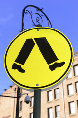 Pedestrian walking sign on street