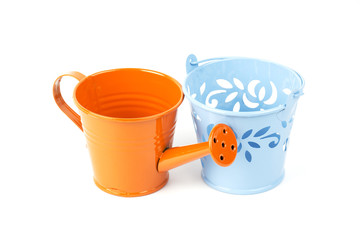 Orange watering can and Blue tree pot