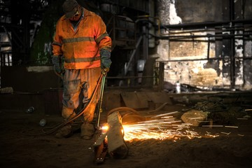 Welding manwith sparks