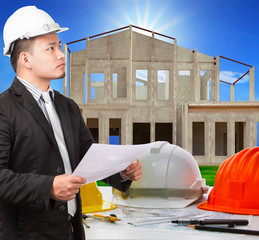 architect man and working ducument plan in house construction si