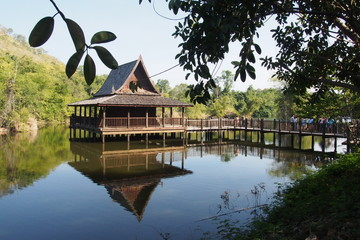 Traditional timber temple on the water