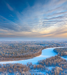Forest river in winter, top view