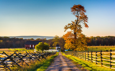 Dirt road to a farm and autumn colors in Gettysburg, Pennsylvani
