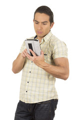 young handsome hispanic man posing using tablet