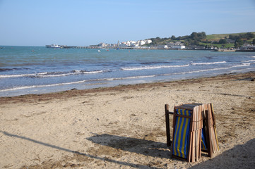 Deckchairs on beach at Swanage in Dorset