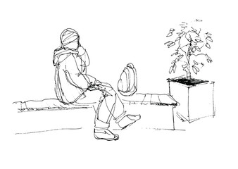 man talking on the phone and sitting on the bench