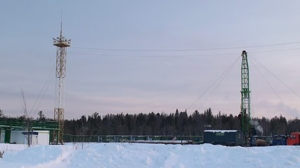 Workover rig in the oilfield at winter.