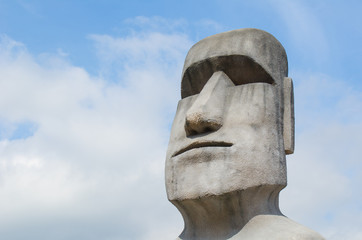 Stone sculpture of a Moai statue.