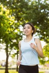 Healthy woman jogging in park