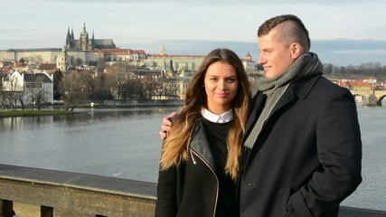 happy couple smile to camera - city (Prague)