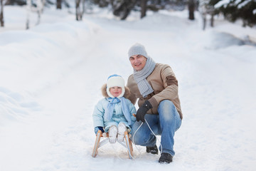 Portrait of Father with Her Child in Winter Park