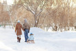 Young parents walking in Winter
