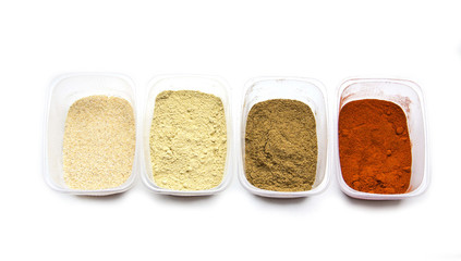 Dried spices in a plastic container