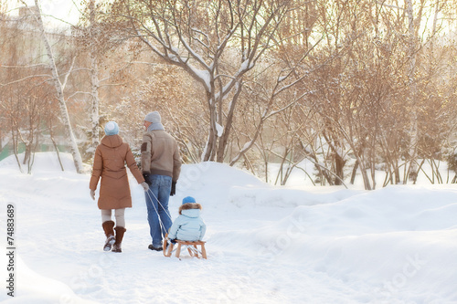 Young parents walking in Winter - 74883689