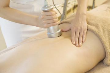 Slimming massage with cavitation