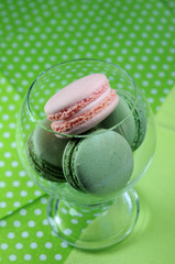 Green pistachio and pink raspberry macarons