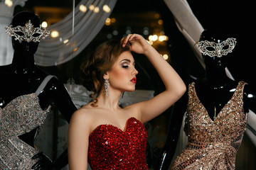fashionable woman posing in red gown