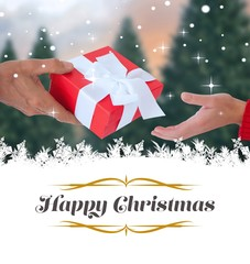 Composite image of couple holding gift