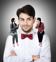 Man with two talking women sitting on his shoulders