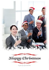 Manager and his team with novelty christmas hat toasting