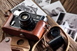 Old rangefinder camera and black-and-white photos. - 74885623