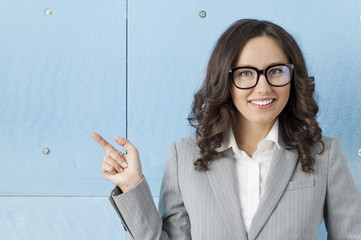 Businesswoman pointing to copy space