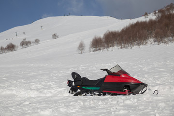 snowmobile in winter mountain